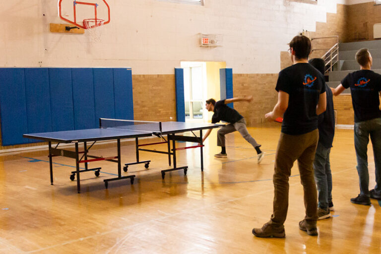 Engineers playing ping pong